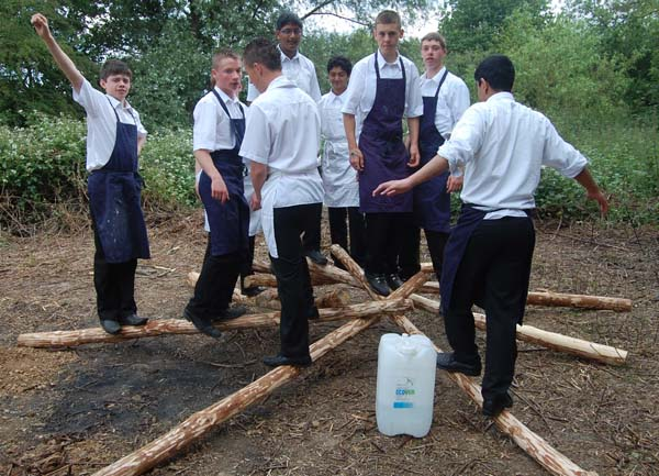 children learning to build roundhouse